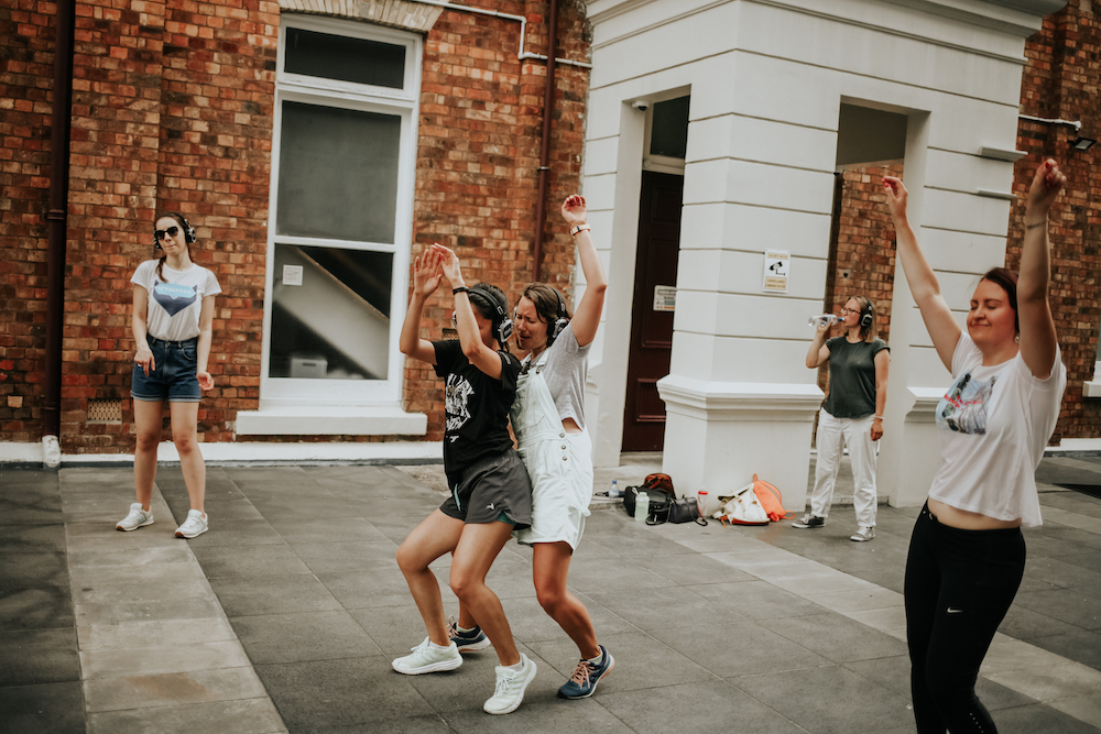 Friends dancing in headphones in Auckland Silent Disco